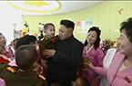 金正恩新年看望孤儿院