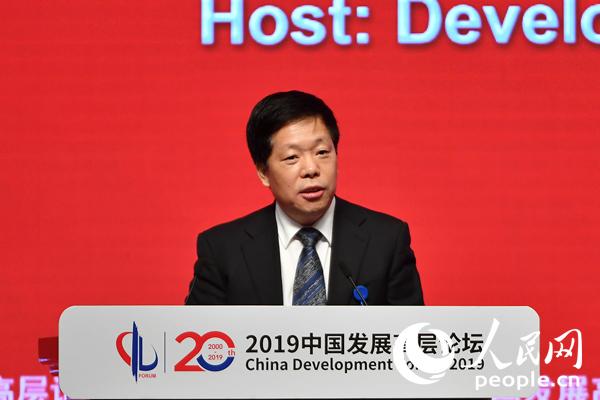 韩文秀:在开放合作中做大蛋糕中国不搞零和游戏